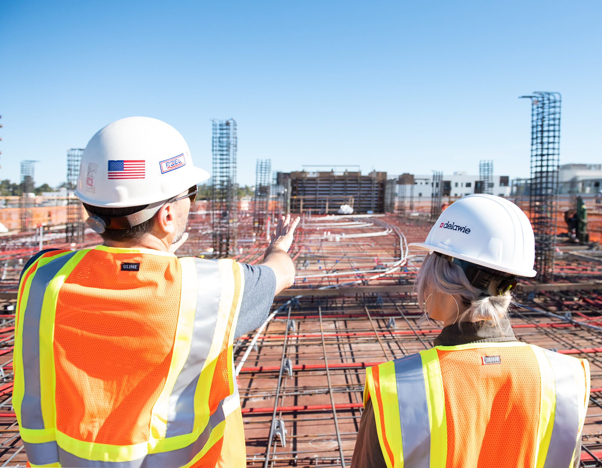 Workers Looking at Construction Site