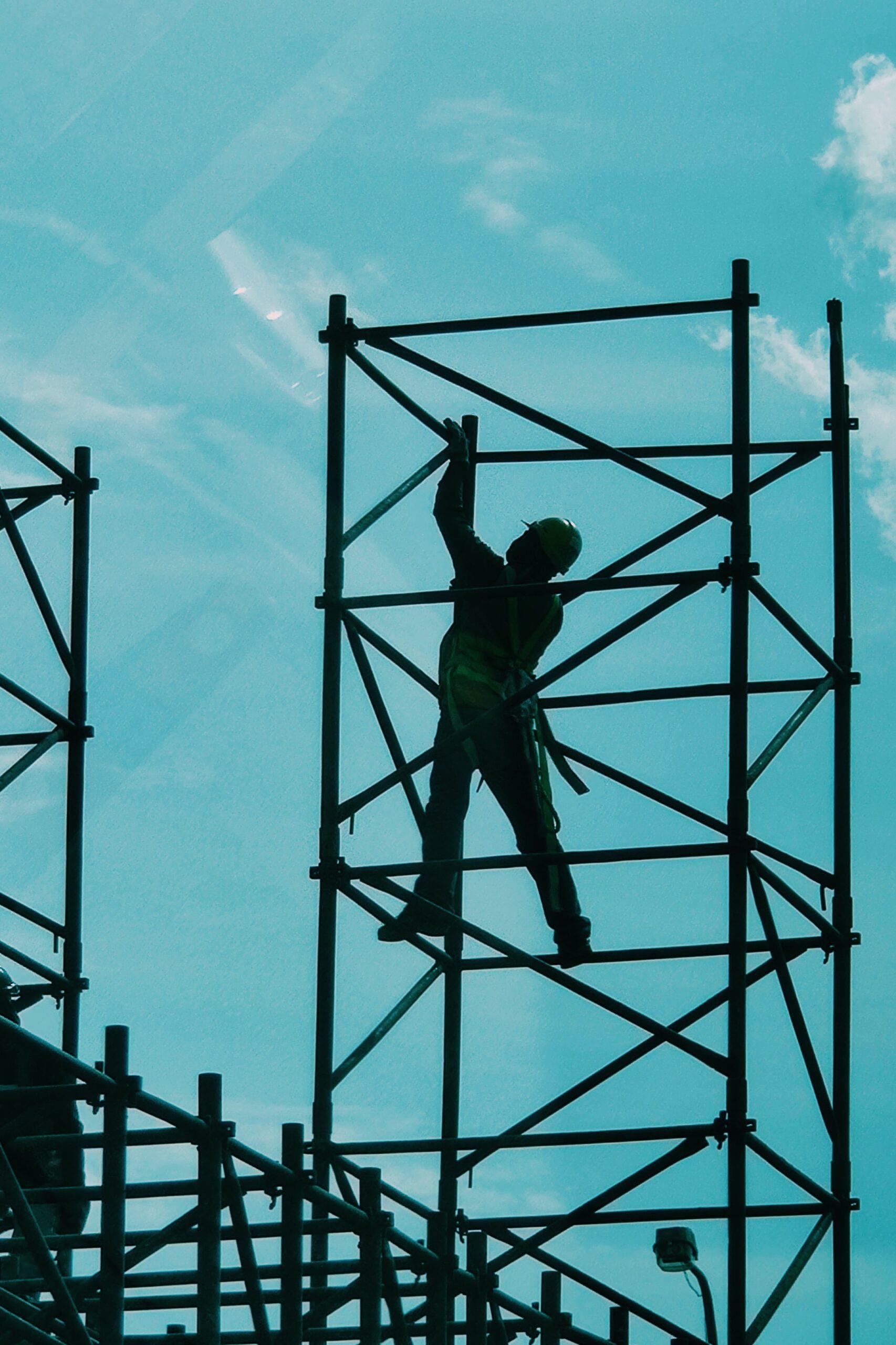 Construction Worker Climbing Scaffolding